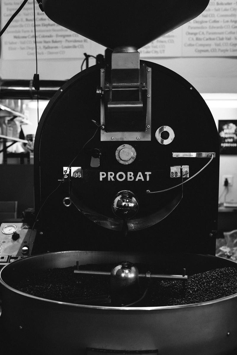 Business Photography, a large coffee turning machine in a warehouse, full with roasted coffee beans