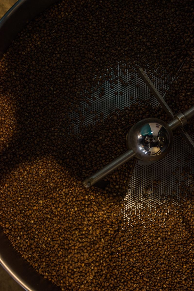 Business Photography, roasted coffee beans piled in roaster
