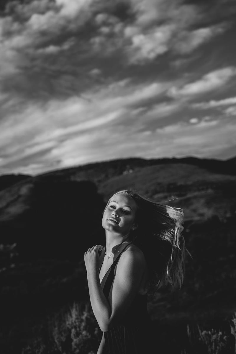 Senior Portrait, black and white photo of High School Woman before hillside
