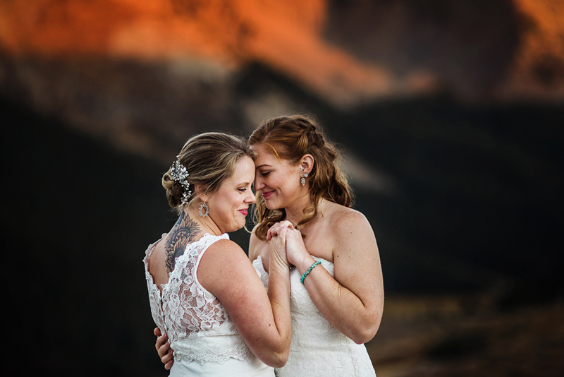 Elopement Photographer, two woman in wedding dresses holding hands
