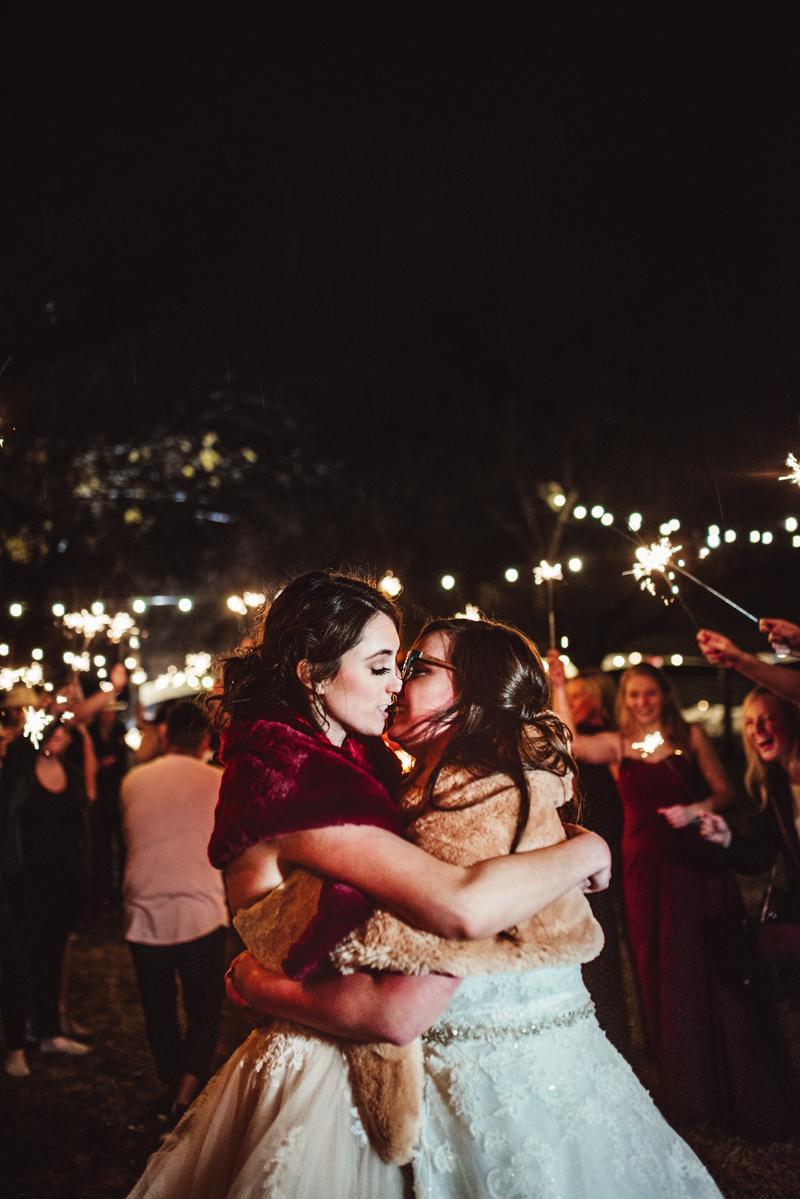 LGBTQ+ Wedding Photography, two women kissing at wedding sendoff