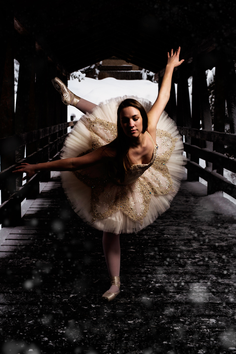 Senior Photographer, teen girl, dancing in a ballet dress in a covered bridge