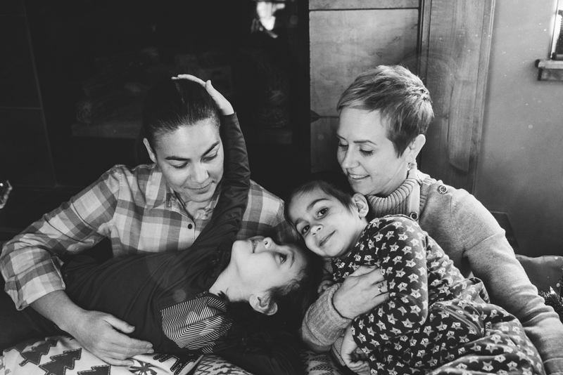 LGBTQ+ Family,  black and white photo, Two mothers hold their two daughters in their arms, everyone smiling